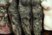 Full Sleeve Tattoo Is Completed With A Black Dragon Representing for sizing 1080 X 1080