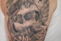Grey Ink Skull And Gun Tattoo On Right Half Sleeve for size 900 X 1350