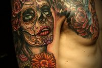 Santa Muerte With Mexican Sugar Skulls Tattoo On Arm And Chest for proportions 800 X 1098