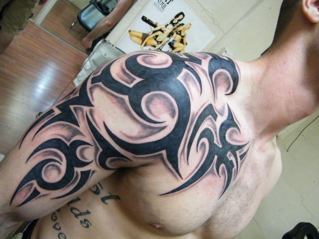 Charming topic men tribal tattoo design