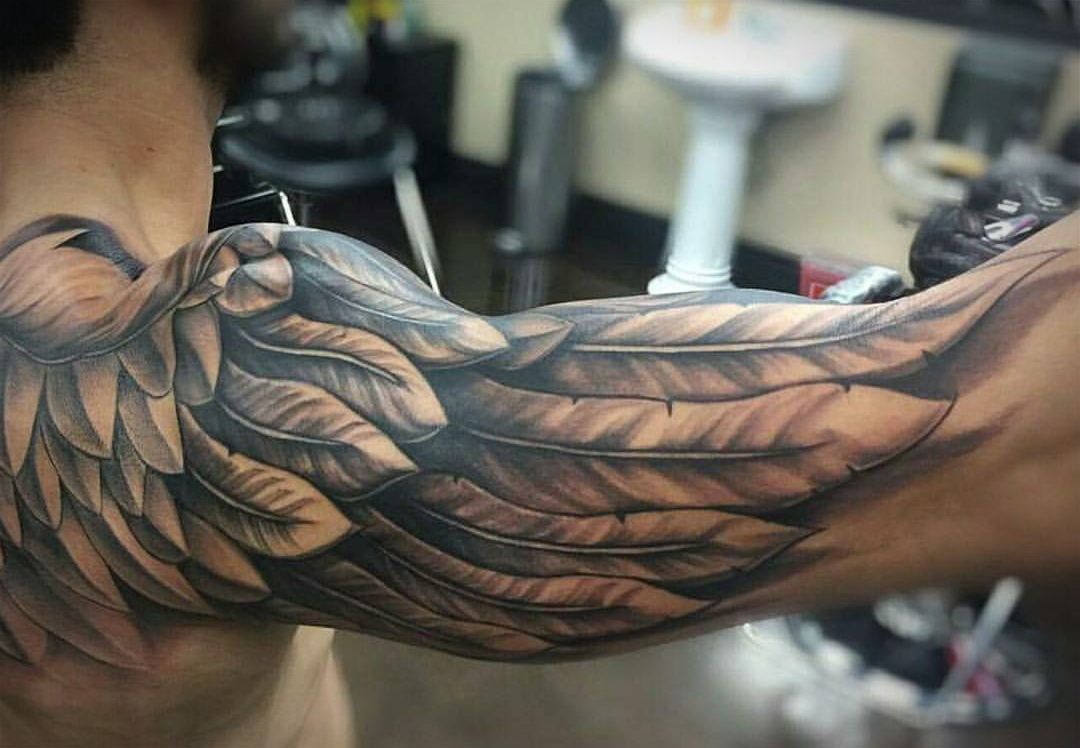 The 109 Best Wing Tattoos For Men Improb throughout sizing 1080 X 748