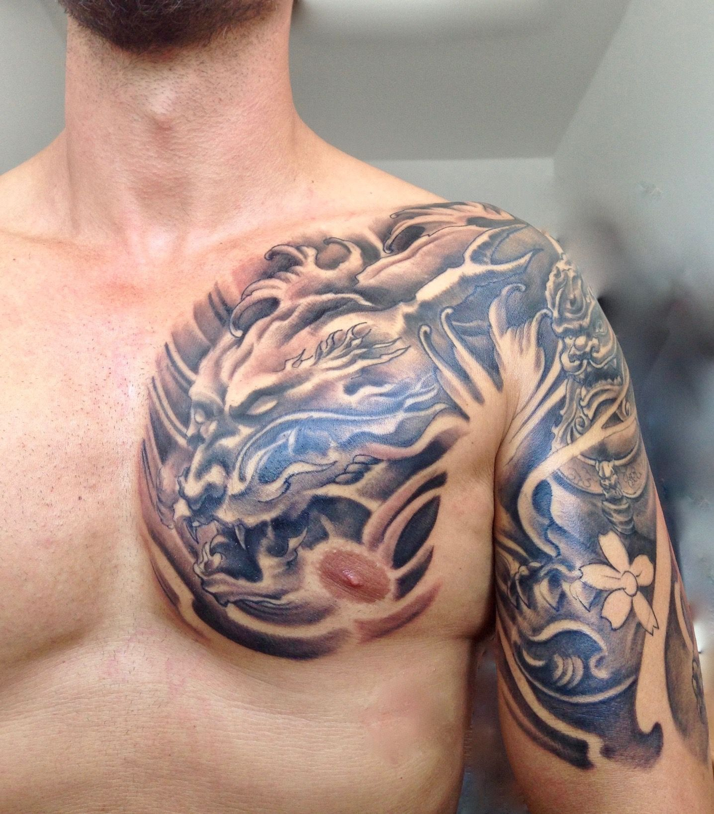 Black And Grey Dragon And Foo Dog Tattoo Left Chest And Halfsleeve pertaining to sizing 1436 X 1636
