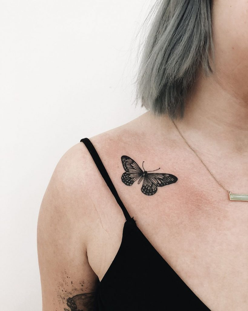 Black Small Butterfly Tattoo On The Clavicle Bone Tattoogrid with regard to proportions 819 X 1024