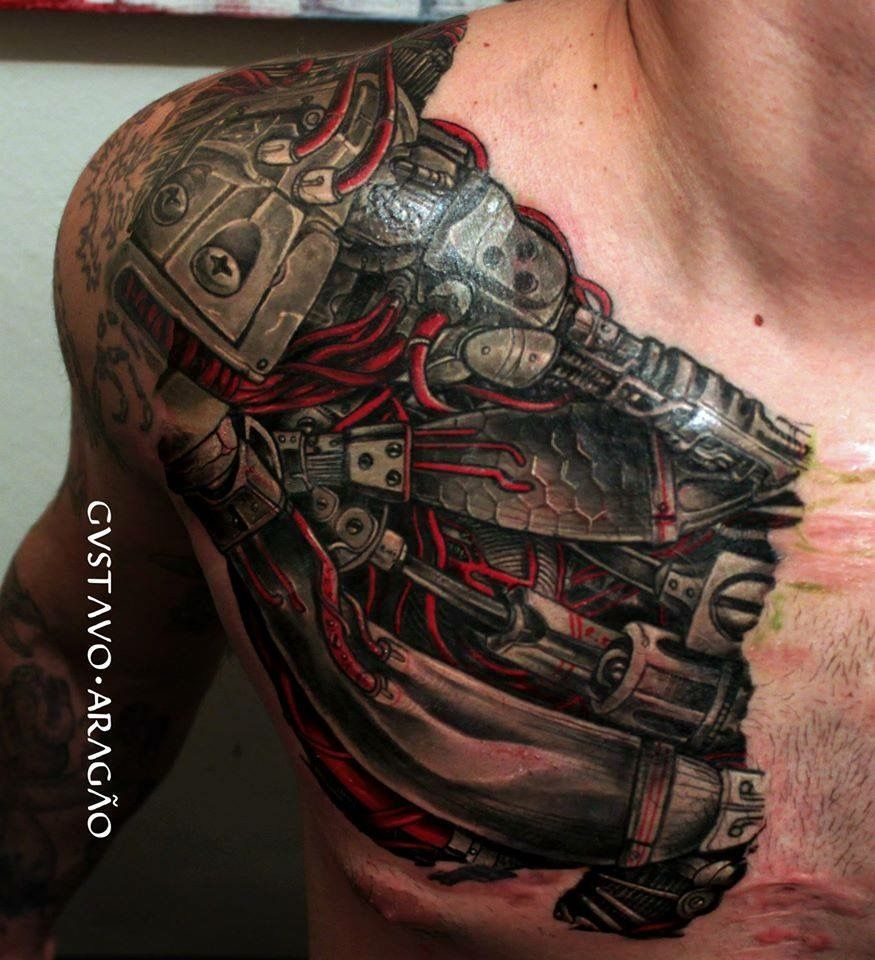 Tatouage Pec Biomechanical Tattoo Ripped Skin Tattoo Tattoos throughout proportions 875 X 960